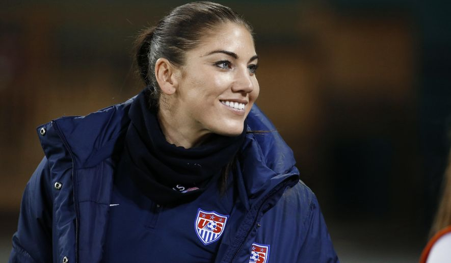 "FILE - In this Oct. 20, 2014, file photo, U.S. goalkeeper Hope Solo stands on the sidelines before a CONCACAF soccer match against Haiti in Washington. Solo had domestic violence assault charges against her dismissed Tuesday, Jan. 13, 2015, ending what she called ""one of the most difficult and emotionally draining times of my life."" (AP Photo/Alex Brandon, File)"