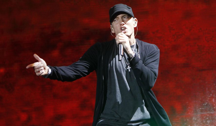 In this Sept. 13, 2010, file photo, rapper Eminem performs at Yankee Stadium in New York. (AP Photo/Jason DeCrow, file)