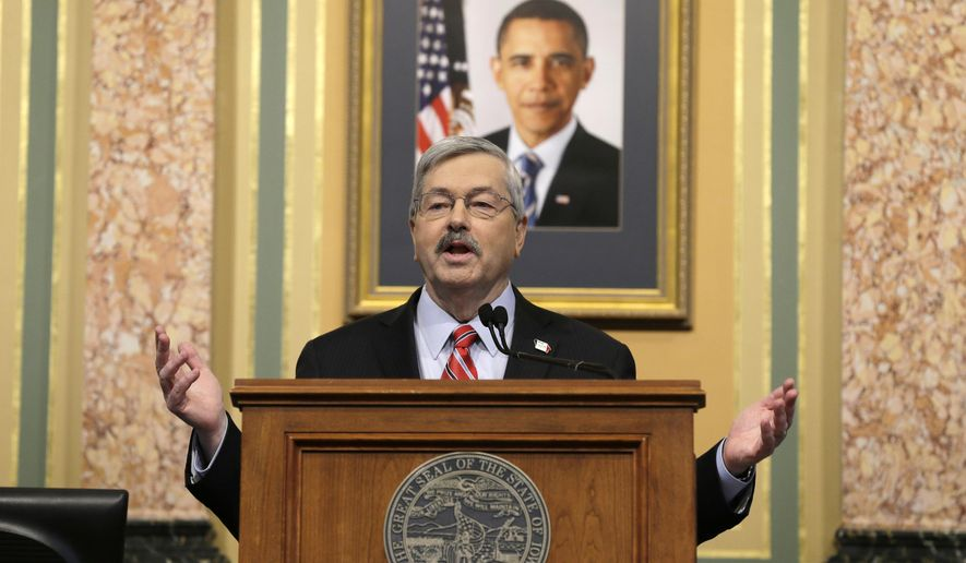 Iowa Gov. Terry Branstad delivers his annual condition of the state address before a joint session of the Iowa Legislature, Tuesday, Jan. 13, 2015, at the Statehouse in Des Moines, Iowa. (AP Photo/Charlie Neibergall)
