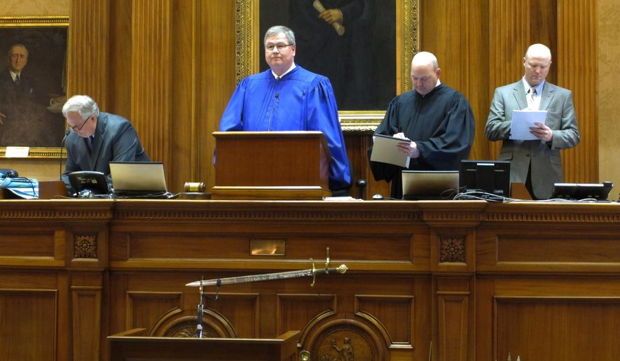 CORRECTS YEAR TO 2015 - South Carolina Lt. Gov. Yancey McGill presides over the Senate on the first day of the legislative session on Tuesday, Jan. 13, 2015, in Columbia, S.C. It is McGill's last day as lieutenant governor as Henry McMaster will take his oath of office Wednesday. (AP Photo/Jeffrey Collins)