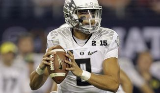 Oregon's Marcus Mariota during the first half of the NCAA college football playoff championship game against Ohio State Monday, Jan. 12, 2015, in Arlington, Texas. (AP Photo/Eric Gay)