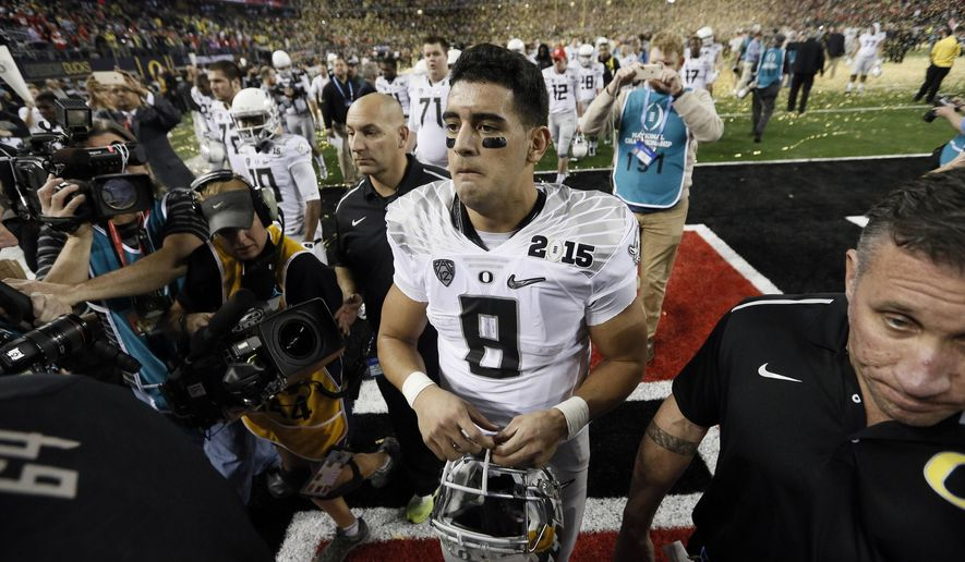 Oregon's Marcus Mariota walks off the field after the NCAA college football playoff championship game against Ohio State Monday, Jan. 12, 2015, in Arlington, Texas. Ohio State won 42-20. (AP Photo/Brandon Wade)