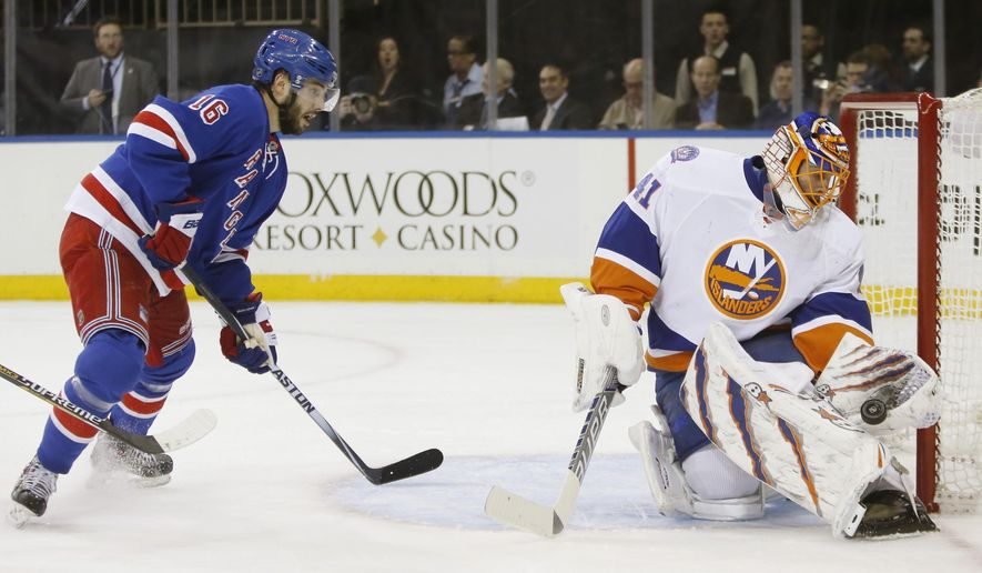 New York Islanders goalie Jaroslav Halak (41) of Slovakia makes a save with New York Rangers center Derick Brassard (16) in front of the crease in the second period of an NHL hockey game at Madison Square Garden in New York, Tuesday, Jan. 13, 2015. (AP Photo/Kathy Willens)