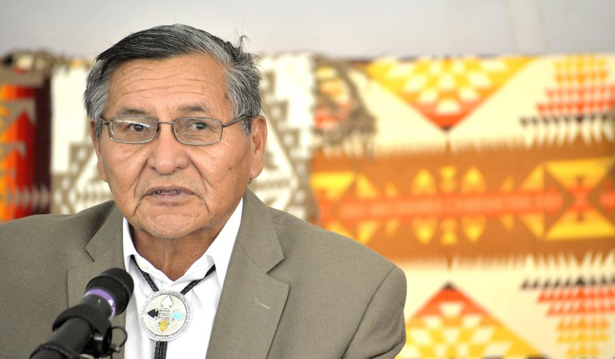 FILE - In this Oct. 7, 2014, file photo, Navajo Nation President Ben Shelly speaks about the importance of the Raytheon Dine Facility being apart of the Navajo Nation during the ground breaking ceremony for company's new $4.4 million, 33,000 square feet warehouse near Farmington, N.M. Shelly will be sworn in as president of the Navajo Nation on  Tuesday, Jan. 13, 2015, to continue as the tribe's top leader, even though he badly lost his re-election bid. That's because the presidency on the country's largest American Indian reservation is in limbo over a disputed election. Ben Shelly struck a deal with tribal lawmakers to remain president until the election dispute gets sorted out. (AP Photo/The Daily Times, Alexa Rogals, File)