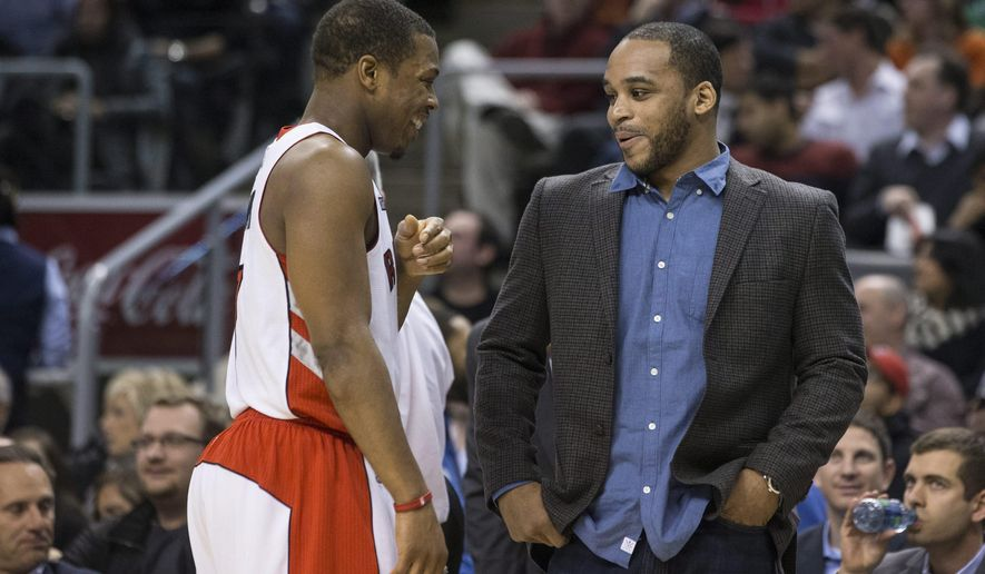 Toronto Raptors' Kyle Lowry, left, jokes with Boston Celtics' Jameer Nelson during an NBA basketball game in Toronto, Saturday, Jan. 10, 2015. (AP Photo/The Canadian Press, Chris Young)