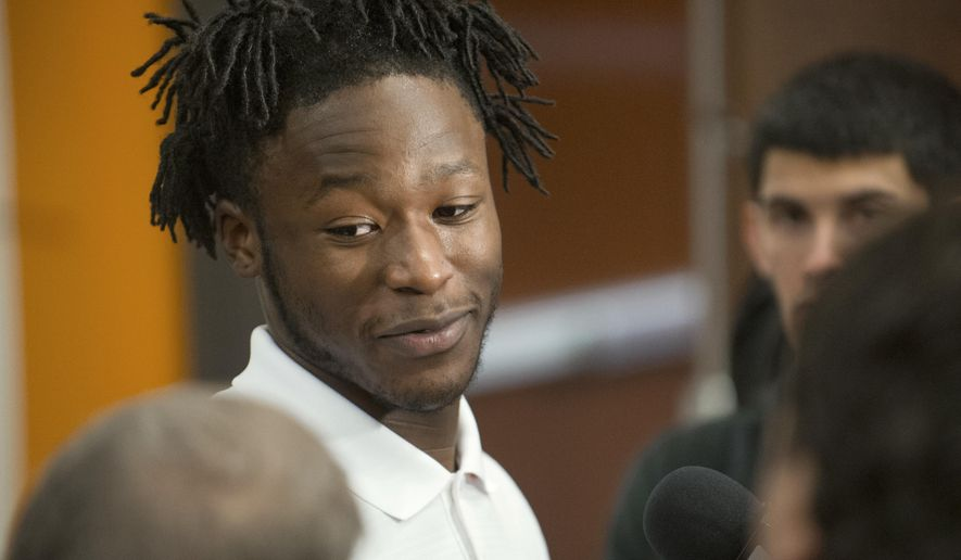 Tennessee running back Alvin Kamara is introduced to the media Tuesday, Jan. 13, 2015, in Knoxville, Tenn. Kamara is a mid-year enrollee who transferred from Hutchinson (Kan.) Community College. (AP Photo/Knoxville News Sentinel, Jessica Tezak)