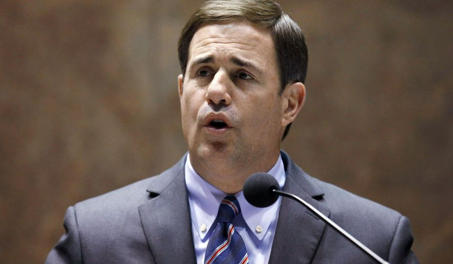 Arizona Gov. Doug Ducey gives his state-of-the-state address at the Arizona Capitol, Monday, Jan. 12, 2015, in Phoenix. (AP Photo/Ross D. Franklin)