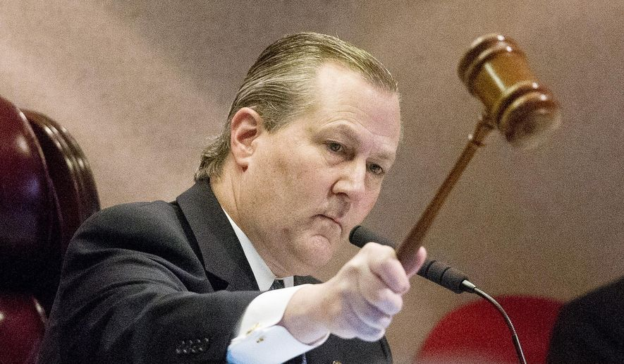 Alabama Rep. Mike Hubbard of Auburn, slams down a gavel after he is re-elected speaker of the House during the Alabama Legislature organizational session, Tuesday, Jan. 13, 2015, in Montgomery, Ala. Hubbard was indicted by a grand jury in October 2014 on 23 charges accusing him of misusing his office as speaker and his previous post as chairman of the Alabama Republican Party.  (AP Photo/Brynn Anderson)