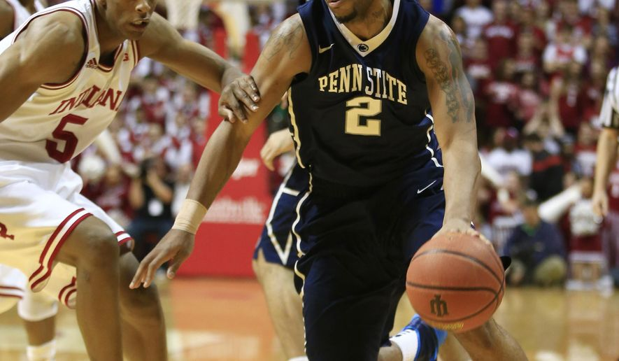 Penn State's D.J. Newbill (2) is defended by Indiana's Troy Williams (5) during the first half of an NCAA college basketball game Tuesday, Jan. 13, 2015, in Bloomington, Ind. (AP Photo/Darron Cummings)