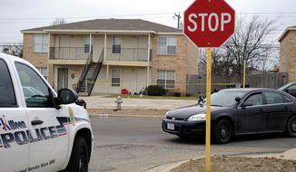 Killeen police investigate the death of a Fort Hood soldier who was found dead at his Killeen, Texas, home on Tuesday, Jan. 13, 2015. (AP Photo/The Killeen Daily Herald, Eric J. Shelton) ** FILE **