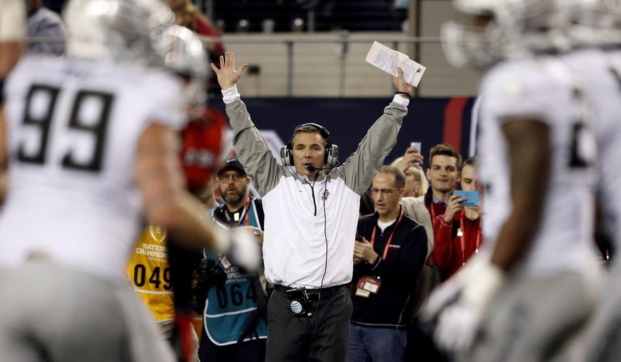 Ohio State head coach Urban Meyer reacts to a call during the second half of the NCAA college football playoff championship game against Oregon Monday, Jan. 12, 2015, in Arlington, Texas. (AP Photo/Brandon Wade)