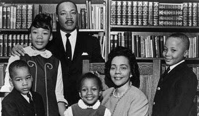 This 1966 file photo is the last official portrait taken of the entire King family, made in the study of Ebenezer Baptist Church in Atlanta. From left are Dexter King, Yolanda King, Martin Luther King Jr., Bernice King, Coretta Scott King and Martin Luther King III. (AP Photo)