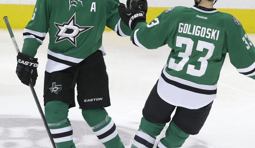 Dallas Stars defenseman Trevor Daley (6) celebrates scoring his goal with teammate Alex Goligoski (33)  during the second period of an NHL hockey game against the Ottawa Senators Tuesday, Jan. 13, 2015, in Dallas. (AP Photo/LM Otero)