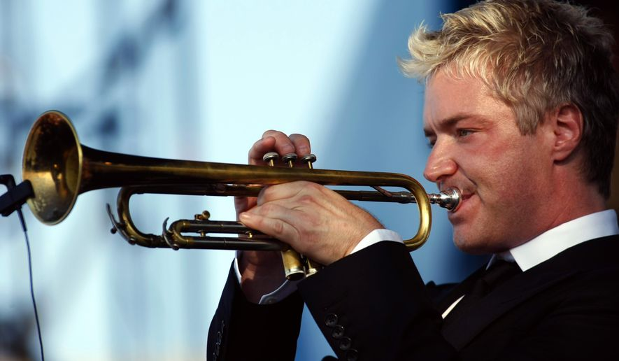 FILE- In this Aug. 8, 2010, file photo, Chris Botti performs at the CareFusion Newport Jazz Festival in Newport, R.I. Festival producer George Wein announced the lineup Tuesday, Jan. 13, 2015, for this years festival and Botti, vocalist Cassandra Wilson and Dr. John are among the biggest names playing. (AP Photo/Joe Giblin, File)