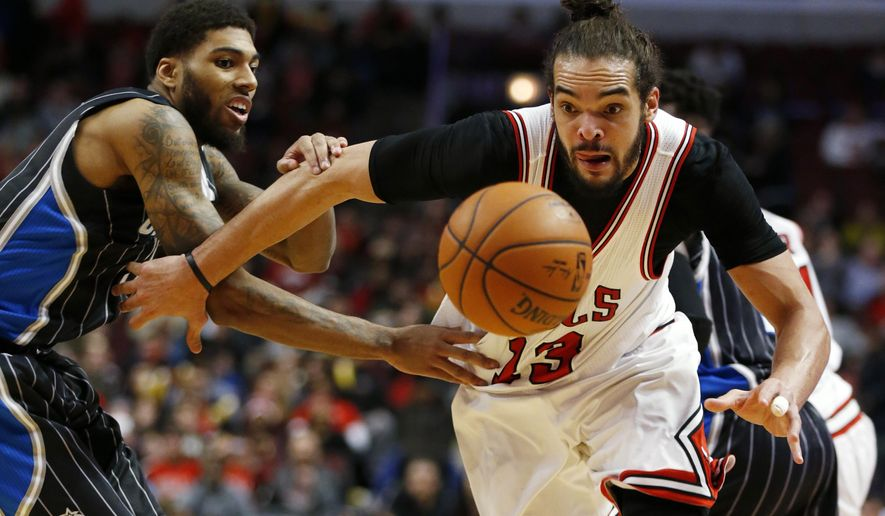 Chicago Bulls forward Joakim Noah (13) chases down a ball with Orlando Magic forward Devyn Marble (11) during the second half of an NBA basketball game on Monday, Jan. 12, 2015, in Chicago. The Orlando Magic won 121-114. (AP Photo/Andrew A. Nelles)