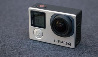 This Dec. 16, 2014 photo shows the GoPro HERO 4 Black camera, in Decatur, Ga. The HERO 4 is capable of shooting ultra-high definition video, also known as 4k video, and has Wi-Fi and Bluetooth technology built in for communication directly with tablets and smartphones. (AP Photo/Ron Harris)