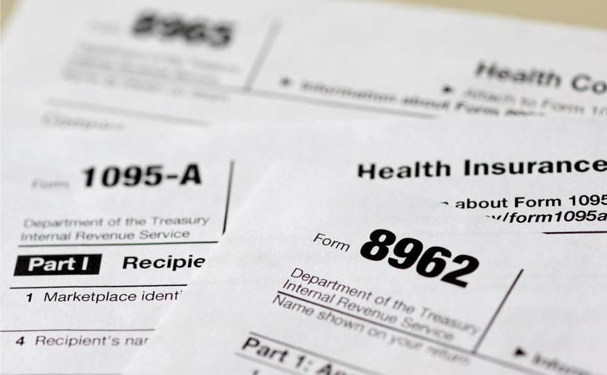 This Aug. 21, 2014, file photo shows health care tax forms 8962, 1095-A, and 8965, in Washington. Being uninsured in America will cost you more in 2015. In 2015, all taxpayers have to report to the Internal Revenue Service for the first time whether or not they had health insurance the previous year. Most will check a box. It's also when the IRS starts collecting fines from some uninsured people, and deciding if others qualify for exemptions. (AP Photo/Carolyn Kaster, File)