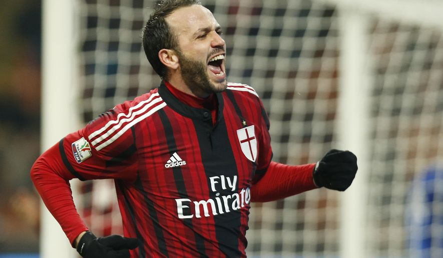 AC Milan's Giampaolo Pazzini celebrates after scoring during the Italian Cup soccer match between AC Milan and Sassuolo at the San Siro stadium in Milan, Italy, Tuesday, Jan. 13, 2015. (AP Photo/Antonio Calanni)
