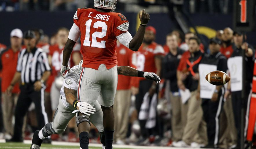 Ohio State's Cardale Jones (12) fumbles the ball during the second half of the NCAA college football playoff championship game against Oregon Monday, Jan. 12, 2015, in Arlington, Texas. (AP Photo/Brandon Wade)
