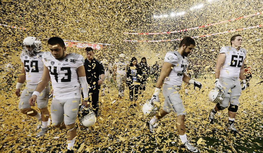 Oregon players walk off the field after the NCAA college football playoff championship game Monday, Jan. 12, 2015, in Arlington, Texas. Ohio State won 42-20. (AP Photo/Brandon Wade)