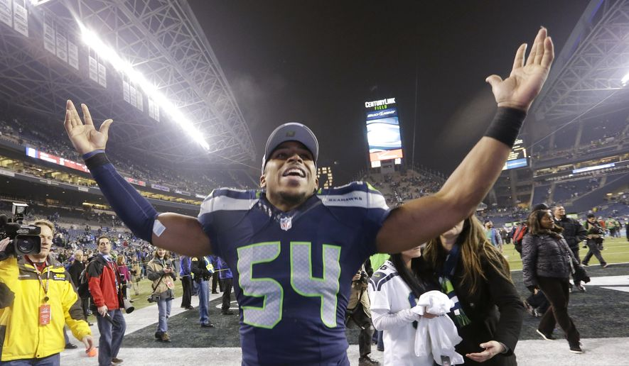 FILE - In this Jan. 19, 2014, file photo, Seattle Seahawks' Bobby Wagner celebrates after the NFL football NFC Championship game in Seattle. The Seahawks draft class of 2012 will reminisce about the way pundits gave them failing grades. The group that was ridiculed and included Russell Wilson, All-Pro Bobby Wagner and linebacker Bruce Irvin is about to play in its second straight NFC championship game.  (AP Photo/Elaine Thompson, File)