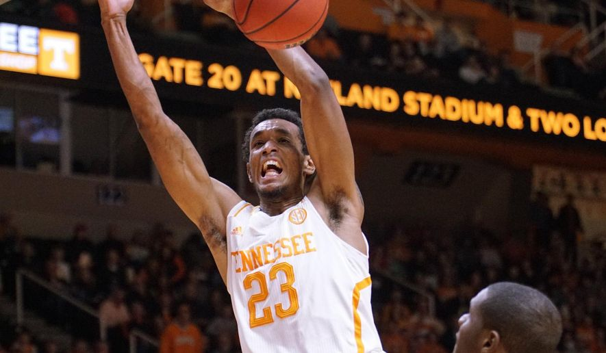 Tennessee's Derek Reese dunks against Arkansas in the first half of an NCAA college basketball game Tuesday, Jan. 13, 2015, in Knoxville, Tenn. (AP Photo/Patrick Murphy-Racey)