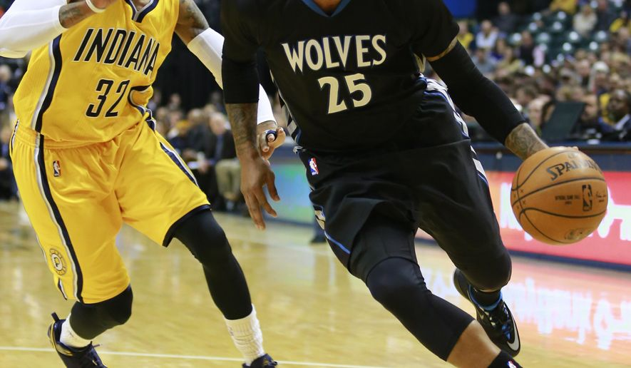 Minnesota Timberwolves guard Mo Williams (25) dribbles the basketball guarded by Indiana Pacers guard C.J. Watson in the first half of an NBA basketball game in Indianapolis, Tuesday, Jan. 13, 2015.  (AP Photo/R Brent Smith)