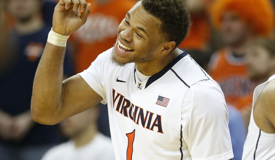 Virginia guard Justin Anderson (1) cheers his team during the second half of an NCAA college basketball game in Charlottesville, Va., Tuesday, Jan. 13, 2015. Virginia won the game 65-42. (AP Photo/Steve Helber)