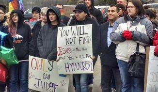 """Protesters held a """"Dignity in Death"""" rally Saturday outside a Denver church after the minister decided to cancel a lesbian's funeral well after the service was supposed to start. (KUSA-TV via @RobLowTV)"""