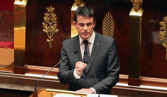 French Prime Minister Manuel Valls, above, speaking at the French National Assembly in homage to the 17 victims of the Jan. 7 terror attacks in Paris, says France is at war with radical Islam. (AP Photo/Remy de la Mauviniere)