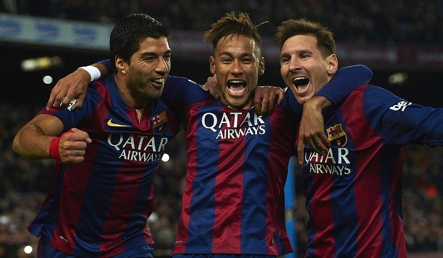 FC Barcelona's Lionel Messi, from Argentine, right, Neymar, from Brazil, center, and Luis Suarez, from Uruguay, celebrate after scoring against Atletico Madrid during a Spanish La Liga soccer match at the Camp Nou stadium in Barcelona, Spain, Sunday, Jan. 11, 2015. (AP Photo/Siu Wu)