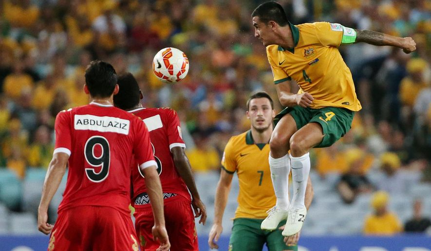 Australia's Tim Cahill is airborne as he heads the ball during the AFC Asian Cup soccer match between Australia and Oman in Sydney, Australia, Tuesday, Jan. 13, 2015. (AP Photo/Rob Griffith)