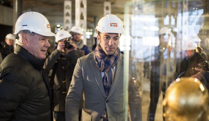 Soccer player Alessandro Del Piero of Italy, right, and former Swiss national coach Koebi Kuhn, left, pose next to the FIFA World Cup trophy during a press conference at the FIFA museum construction site in Zurich, Switzerland, Tuesday, Jan. 13, 2015. The FIFA World Football Museum is due to open early 2016. (AP Photo/Keystone, Ennio Leanza)