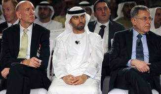 From left to right, Richard Doidge Managing Director of Maersk Oil Middle East, Suhail bin Mohammed al-Mazroui, UAE Oil Minister and Fouad Siniora former Lebanese Prime Minister take part in the 6th Gulf Intelligence UAE Energy Forum in Abu Dhabi, United Arab Emirates, Tuesday, Jan. 13, 2015. (AP Photo/Kamran Jebreili)