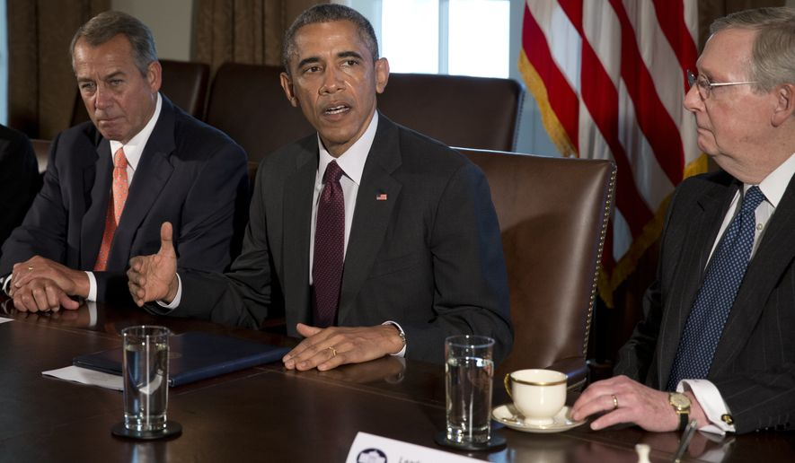 President Barack Obama, flanked by House Speaker John Boehner of Ohio, left, and Senate Majority Leader Mitch McConnell of Ky., speaks to media as he meets with bipartisan, bicameral leadership of Congress to discuss a wide range of issues, Tuesday, Jan. 13, 2015, in the Cabinet Room of the White House in Washington. (AP Photo/Carolyn Kaster)
