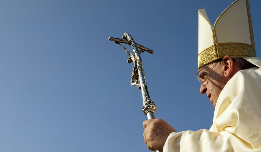 Pope Francis, holding his pastoral staff, arrives in Colombo's seafront Galle Face Green for the  canonization ceremony of Joseph Vaz, Wednesday, Jan. 14, 2015. Francis declared Vaz a saint at the start of the service. The church considers Vaz a great model for today's faithful, ministering to the faithful of both Sri Lanka's ethnic groups and putting himself at great risk to spread the faith. (AP Photo/Alessandra Tarantino)