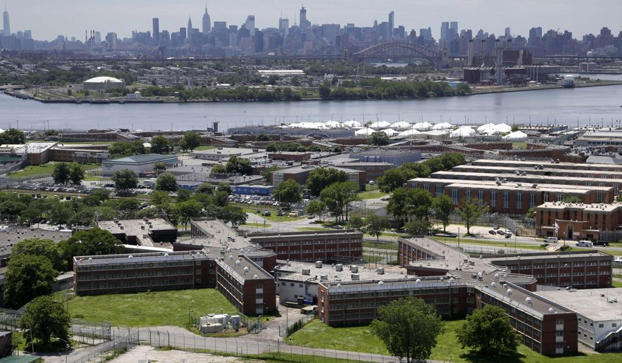 FILE - In this this June 20, 2014, file photo, the Rikers Island jail complex stands in the foreground with the New York skyline in the background. In the midst of heightened scrutiny to reform New York City's jails, reports of violence by guards against inmates reached an all-time high in 2014, according to documents obtained by The Associated Press. (AP Photo/Seth Wenig, File)