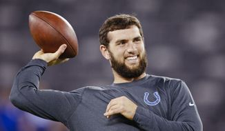 FILE - In this Nov. 3, 2014, file photo, Indianapolis Colts quarterback Andrew Luck (12) throws a pass while warming up before an NFL football game against the New York Giants in East Rutherford, N.J. No Tom Brady-Peyton Manning rematch this time. Instead, it will be Brady and Andrew Luck meeting again in a matchup of star quarterbacks when the New England Patriots host the Indianapolis Colts in the AFC championship game Sunday. (AP Photo/Kathy Willens, File)