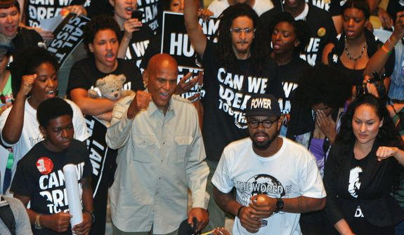 "Singer and social activist Harry Belafonte Jr. (center) worked with organizations that established the ""Heads Up Coalition,"" funded by George Soros' Tides Foundation, based on later-debunked notions that Michael Brown's hands were up before being shot. (associated press)"