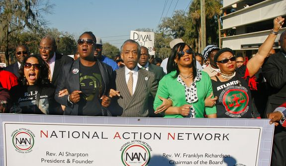 "From left, participants including Lucia McBath, mother of Jordan Davis, Sybrina Fulton, mother of Trayvon Martin, Rev. Al Sharpton, president of National Action Network, and Phyllis Giles, mother of Michael Giles, march to the Florida Capitol Monday, March 10, 2014, in Tallahassee, Fla. Participants were rallying against the state's ""Stand Your Ground"" laws. (AP Photo/Phil Sears)"