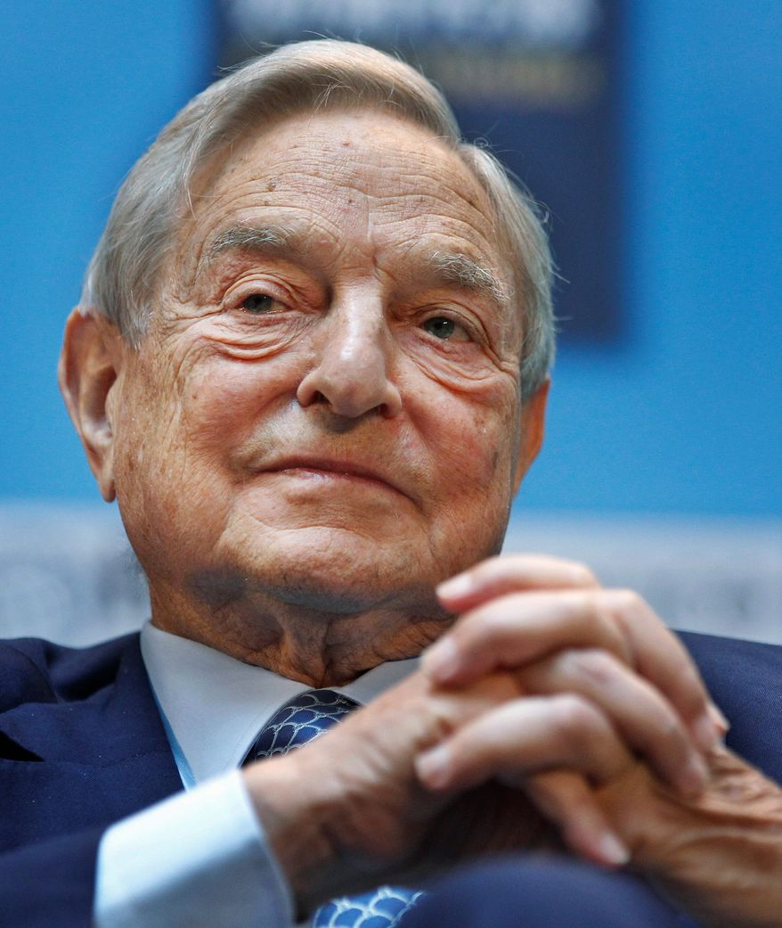 """Billionaire George Soros has taken an eagle's eye approach to funding the Ferguson activities of Al Sharpton, the """"Hands Up, Don't Shoot"""" campaign and protests linking Michael Brown's and Trayvon Martin's deaths. (Associated Press)"""