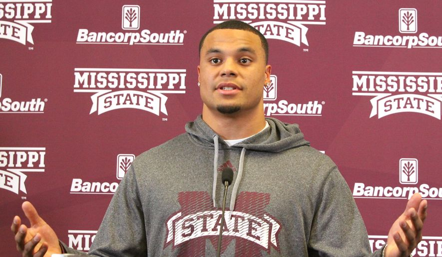 Mississippi State quarterback Dak Prescott announces that he will stay for another year and not enter the NFL draft during an NCAA college football news conference, Wednesday, Jan. 14, 2015, in Starkville, Miss.. (AP Photo/Jim Lytle)