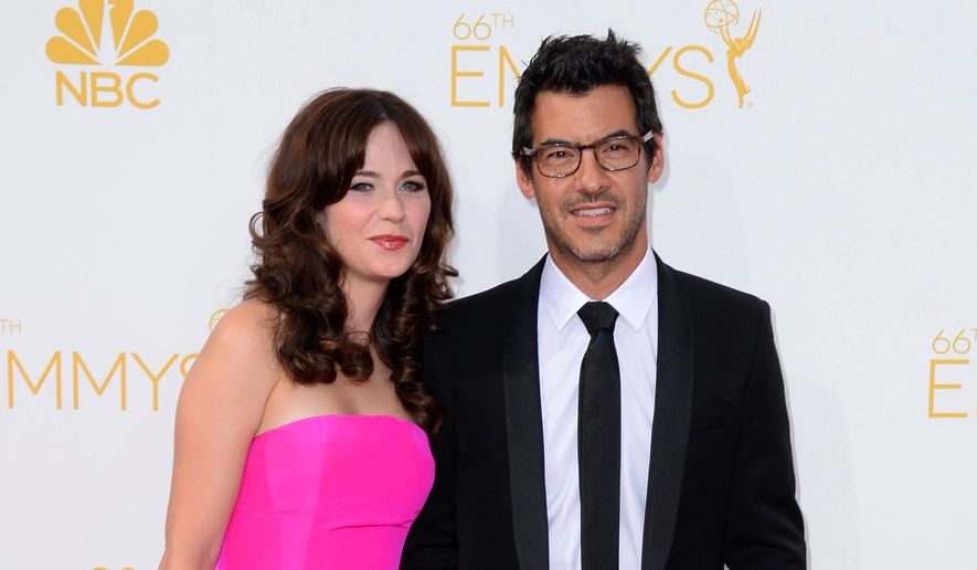 Zooey Deschanel, left and Jacob Pechenik arrive at the 66th Annual Primetime Emmy Awards at the Nokia Theatre L.A. Live on Monday, Aug. 25, 2014, in Los Angeles. (Photo by Jordan Strauss/Invision/AP, File)