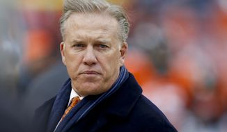 Denver Broncos Executive Vice President of Football Operations and General Manager, John Elway, watches his players prior to an NFL divisional playoff football game against the Indianapolis Colts, Sunday, Jan. 11, 2015, in Denver. (AP Photo/David Zalubowski)