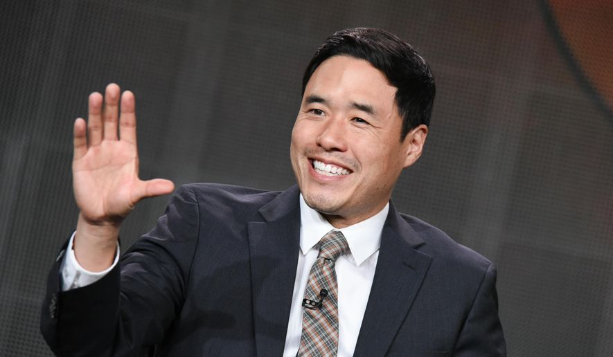 """Randall Park speaks during the """"Fresh Off the Boat"""" panel at the Disney/ABC Television Group 2015 Winter TCA on Wednesday, Jan. 14, 2015, in Pasadena, Calif. (Photo by Richard Shotwell/Invision/AP)"""
