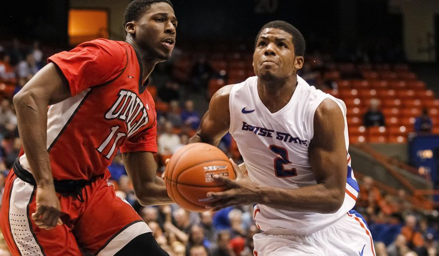 Boise State's Derrick Marks (2) looks to the basket past UNLV's Goodluck Okonoboh (11) during the second half of an NCAA college basketball game in Boise, Idaho, on Tuesday, Jan. 13, 2015. Boise State won 82-73 in overtime. (AP Photo/Otto Kitsinger)