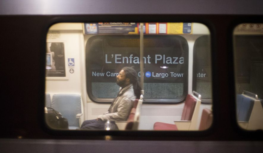 """A passenger is seen riding a subway train as it leaves the L'Enfant Metro Station in Washington, Tuesday, Jan. 13, 2015, part of the public mass transit network for Washington. The transit network in the nation's capital, remains hobbled after an electrical malfunction that filled a L'Enfant Metro subway station with smoke, killing one woman and sending dozens of people to hospitals. The NTSB is investigating the incident, which happened at the beginning of the Monday afternoon rush hour. It led to the first fatality on Washington's Metro system since a 2009 crash that killed eight passengers and a train operator. NTSB investigator Michael Flanigon told reporters that an electrical """"arcing"""" involving the high-voltage third rail led a train to stop in a tunnel and filled the tunnel with smoke. An arcing occurs when electricity from the third rail comes into contact with another substance that conducts electricity, such as water. (AP Photo/Pablo Martinez Monsivais)"""