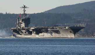 This photo taken Dec. 1, 2014, shows the aircraft carrier USS John Stennis near Bremerton, Wash. On Monday, Jan. 12, 2015, the ship sailed from Naval Base Kitsap in Bremerton, Wash., to Naval Magazine Indian Island, Wash., in order to take on ammunition before a training mission in the Pacific Ocean near San Diego, Calif. ((AP Photo/Kitsap Sun, Larry Steagall)