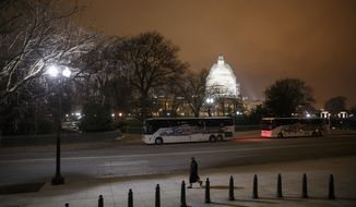 The U.S. Capitol in Washington is seen Wednesday evening, Jan. 14, 2015. A man who plotted to attack the U.S. congressional building and kill government officials inside it and spoke of his desire to support the Islamic State group was arrested on Wednesday, the FBI said. The Capitol Dome is covered with scaffolding for a long-term repair project.  (AP Photo/J. Scott Applewhite)