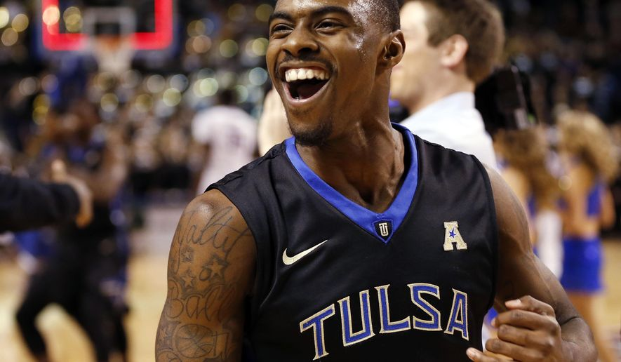 Tulsa's Rashad Ray (5) celebrates his team's 66-58 win during the NCAA college basketball game against UConn at the Reynolds Center in Tulsa, Okla. on Tuesday, Jan. 13, 2015. (AP Photo/Tulsa World, Cory Young)